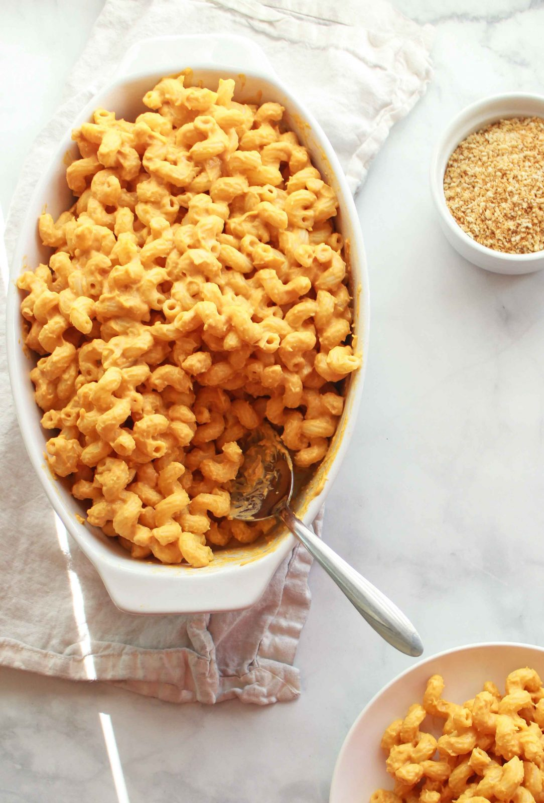This vegan sweet potato mac and cheese is gluten free, nut free, and a delicious side dish for the holidays.