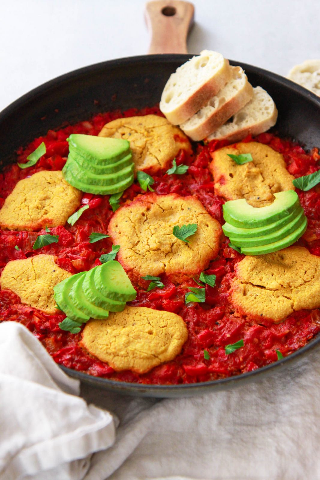 This vegan shakshuka make a delicious Middle Eastern breakfast. This Mediterranean brunch recipe is made plant based using chickpea based eggs baked in a tomato and red pepper sauce.