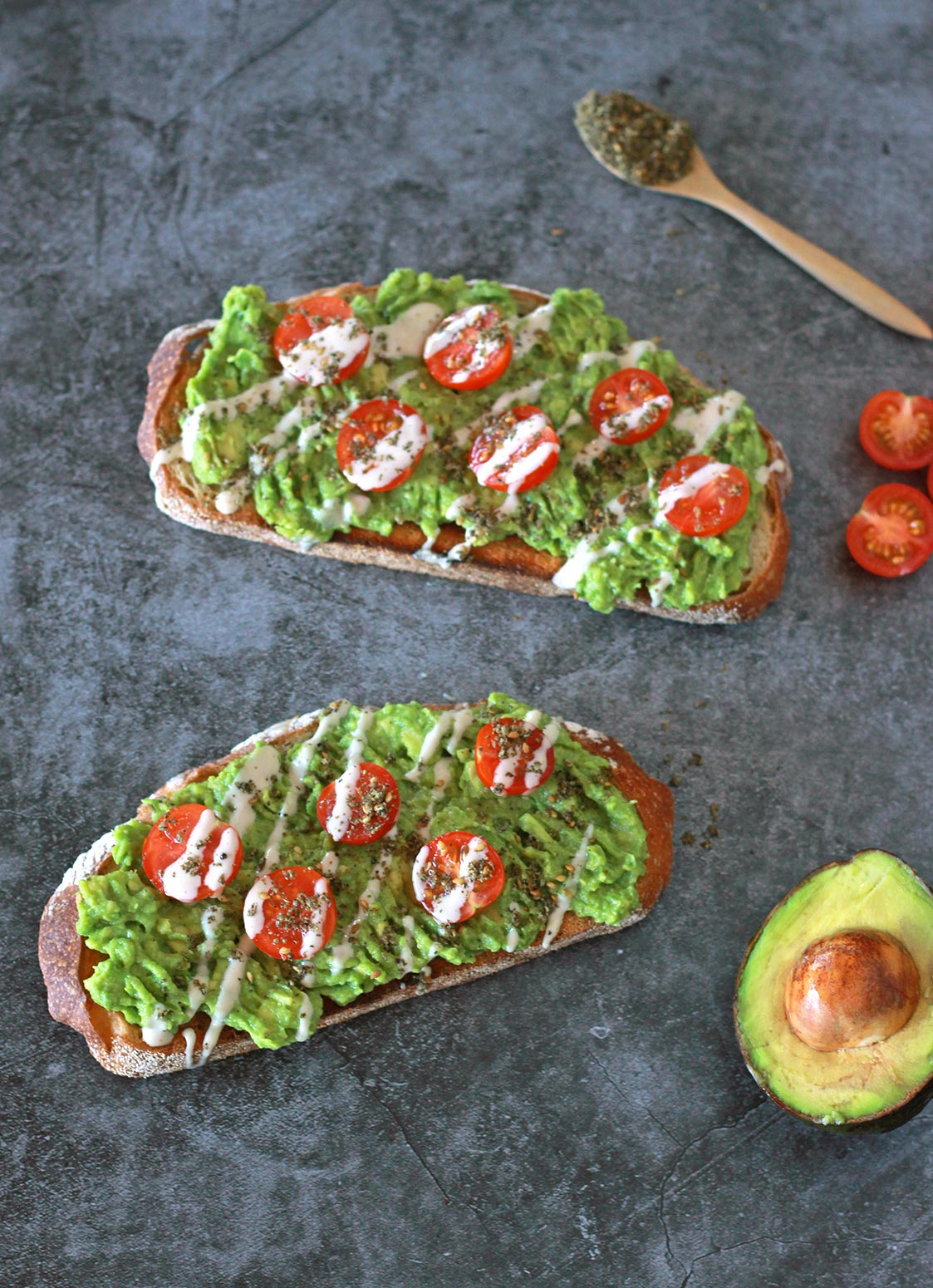 This zaatar avocado toast is a Mediterranean twist on your classic avocado toast, dressed with juicy cherry tomatoes and a creamy 3-ingredient tahini drizzle. This vegan recipe is a modern twist on the classic Middle Eastern breakfast staple of bread with zaatar and olive oil.