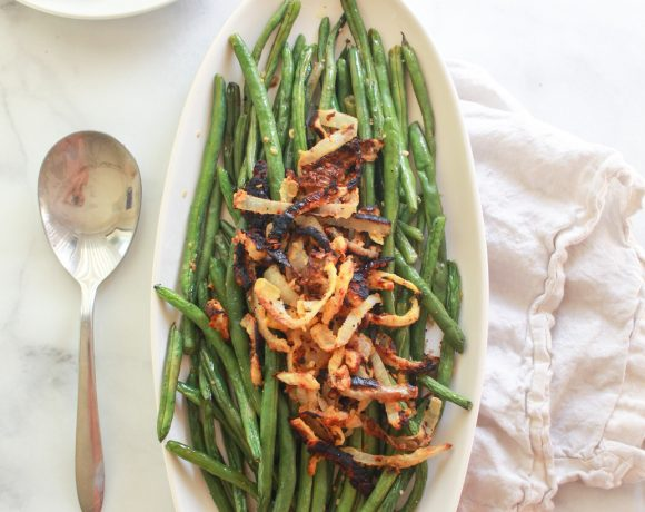 These oven roasted lemon garlic green beans topped with chickpea fried onions make a delicious vegan Thanksgiving side dish.