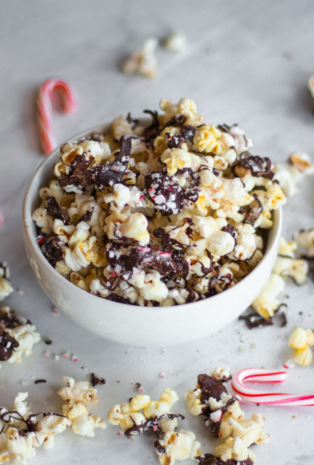 This vegan and gluten-free peppermint bark popcorn is the perfect holiday treat. Covered in crushed candy canes and dark chocolate, this Christmas recipe had a satisfying combination of sweet and savory notes.