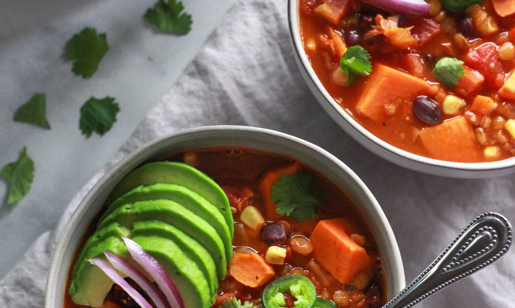 This warming lentil and sweet potato chili is the perfect comfort food for colder months. Packed full of flavor, this vegan sweet potato chili recipe is also gluten-free.