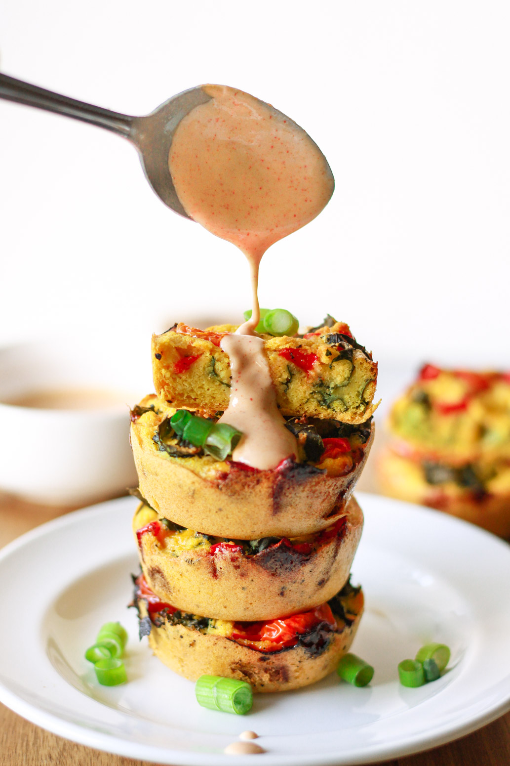 How to make vegan egg muffins without chickpeas or tofu! This mung bean based egg alternative is gluten-free and can be customized to your liking with tomatoes, kale, and other veggies. These vegan egg muffins are ready in 20 minutes and can be served with a tahini dip.