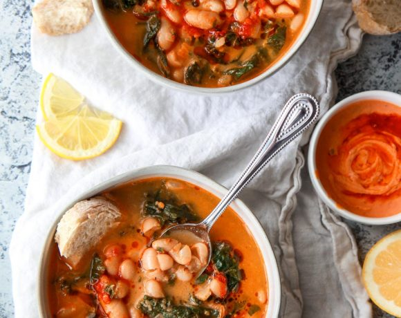 This Mediterranean white bean soup is flavored with Harissa and tahini. Filled with kale, parsley, and thyme, this vegan white bean soup is hearty, flavorful, and creamy.