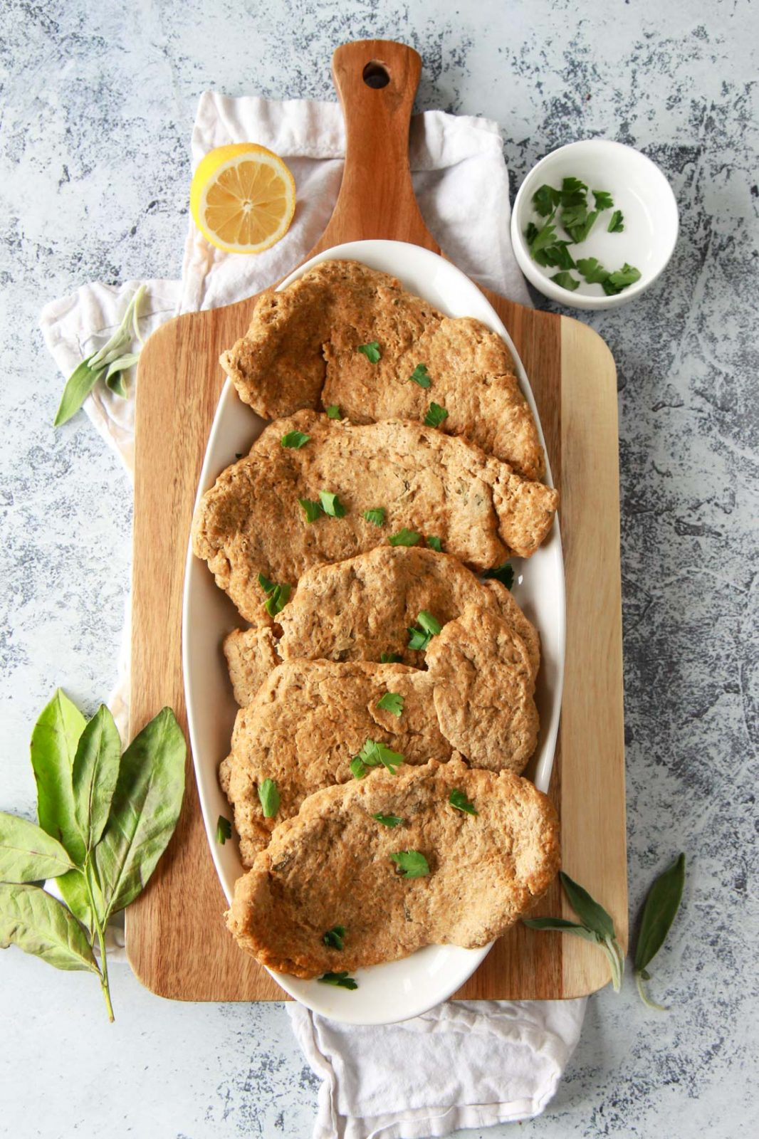 These seitan chicken cutlets are easy and versatile. A vegan meat replacement, these seitan chicken breasts are simmered and done in under an hour. This plant based chicken alternative recipe is made from vital wheat gluten, packed with protein, and flavored with savory herbs.