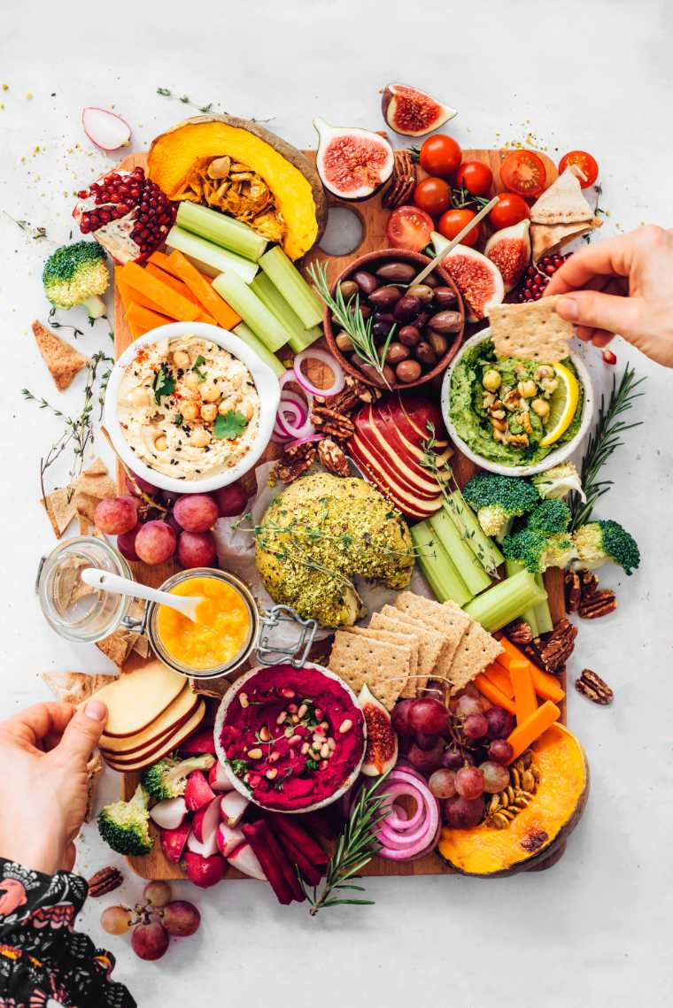 This vegan hummus and cheese platter makes a delicious vegan Thanksgiving appetizer.