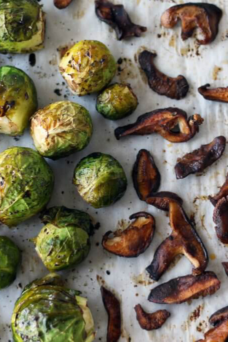 These vegan brussels sprouts with shiitake bacon and maple dijon dip make a delicious holiday side dish.