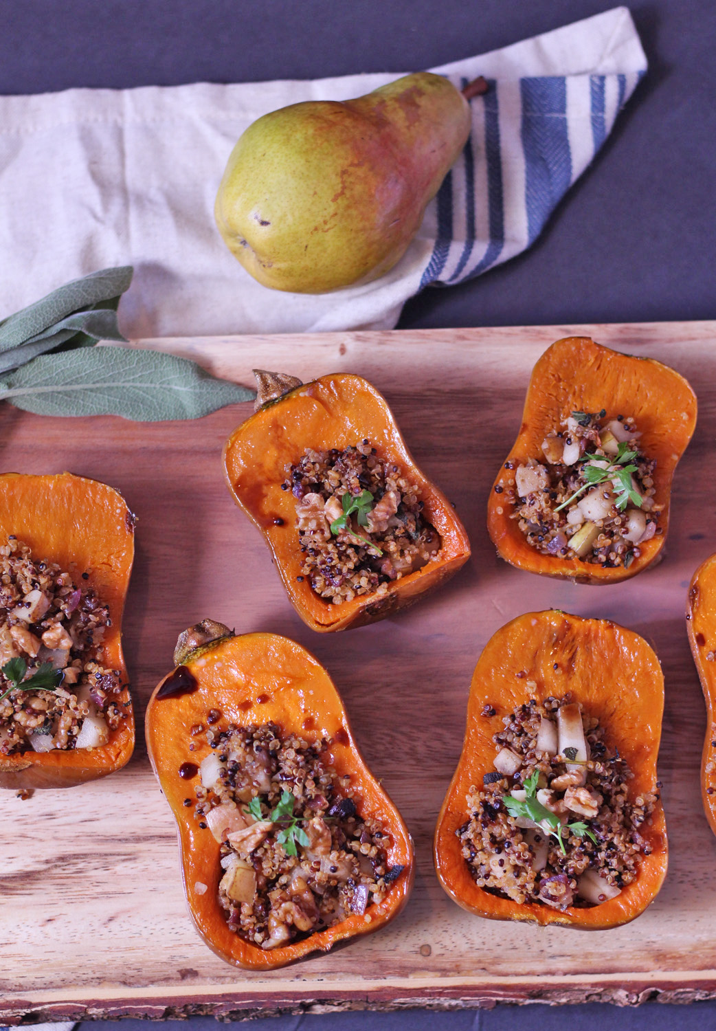 This stuffed butternut squash with a quinoa pear filling is a unique and filling main dish for Thanksgiving.